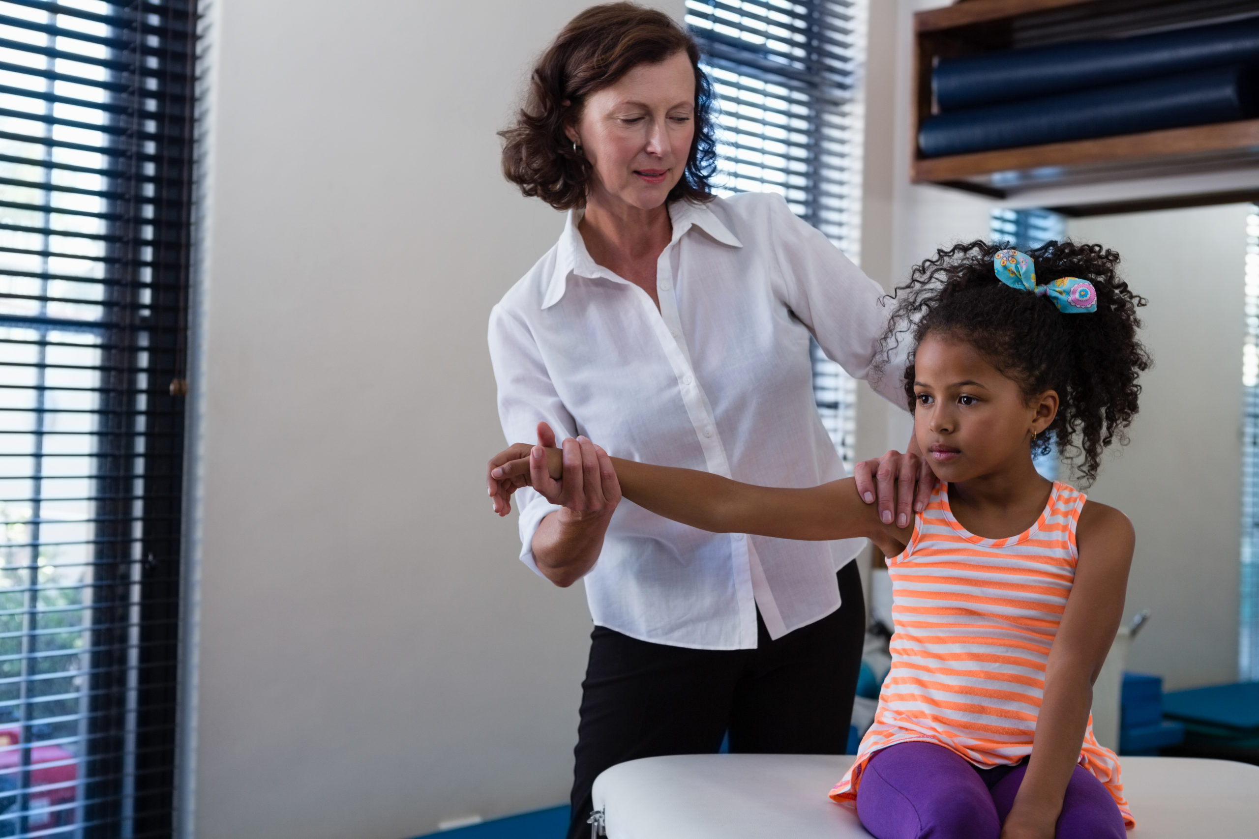 Girl doing Phycial Therapy - First Steps Pediatric Therapy