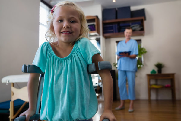 First Steps Pediatric Therapy Specialist - little girl walking on crutches